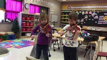 Adam & Kayla playing their violins!