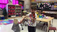 Adam playing hot cross buns with his violin for the class!
